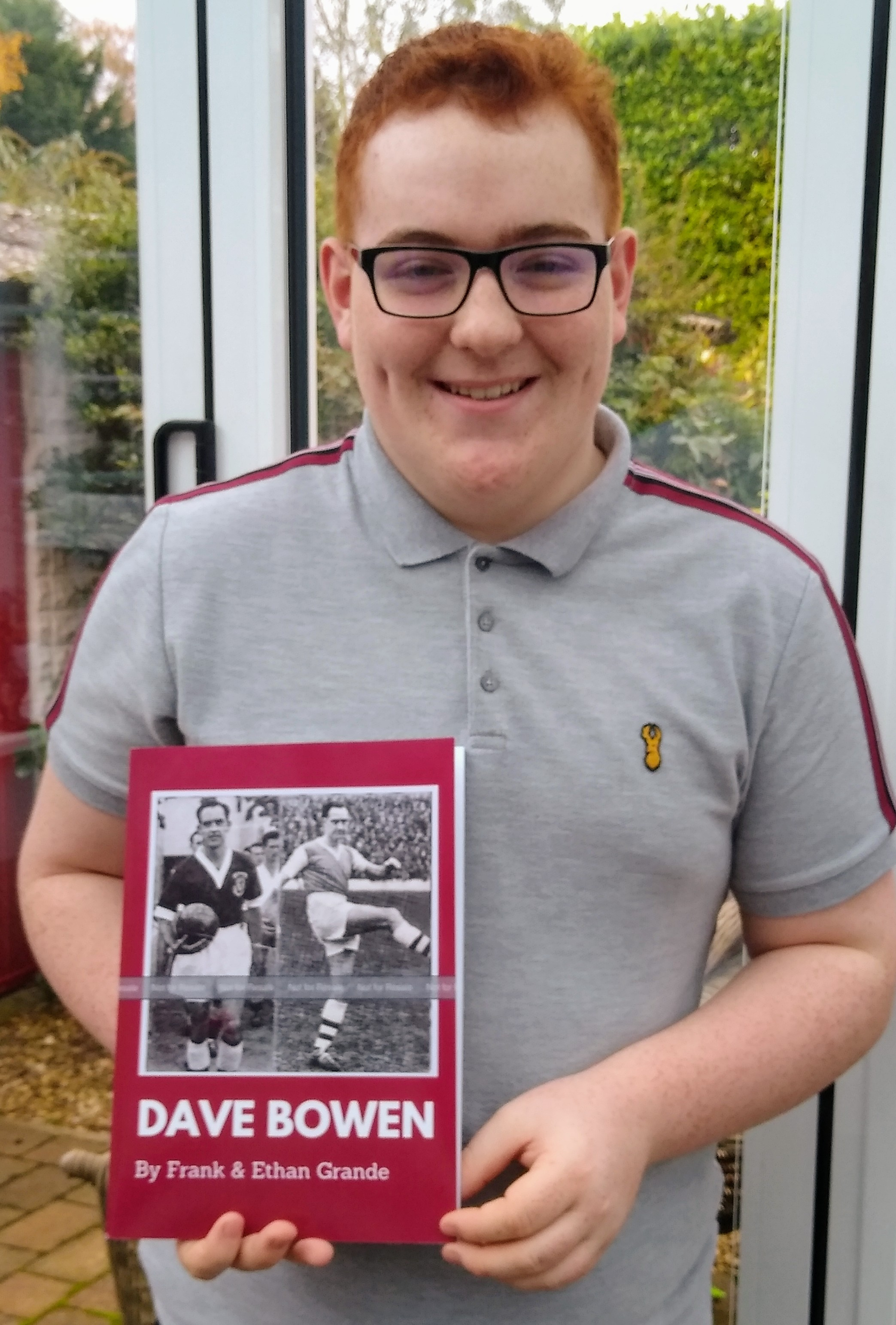 Ethan is pictured with the new football book, dedicated to the life and times of Northampton Town FC legend Dave Bowen